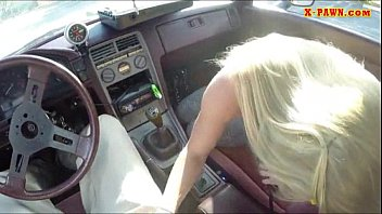 Blonde bimbo gives a road head while test driving her car