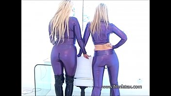 Lesbian latex fetish babes intimate shiny rubber playing and bedroom babes cares