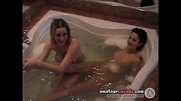 Teen is massaged by mature busty lesbian in hot tub party